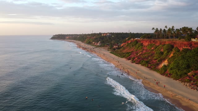 aerial view of beach and cliffs in varkala at sunset, kerala - coastal feature stock videos & royalty-free footage