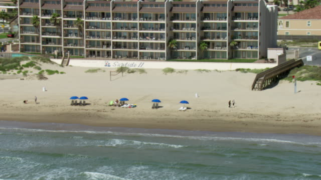 aerial view of beach and hotel buildings on south padre island, texas, united states of america. - gulf of mexico stock videos & royalty-free footage