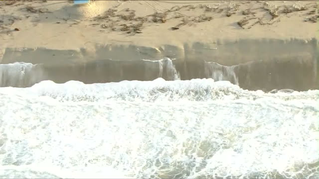ktla aerial view of beach erosion after storm - eroded stock videos & royalty-free footage