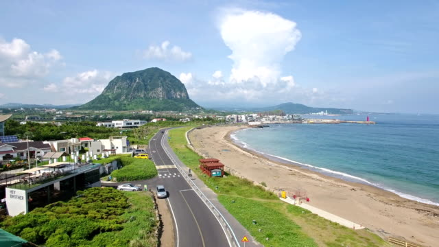 Aerial view of beach side of Coastal Village and Sanbangsan mountain in distance