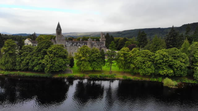 aerial view of beautiful abbey with the loch ness in scotland. - scottish culture video stock e b–roll