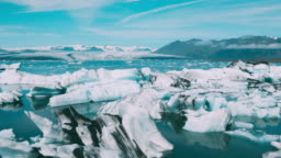 Aerial view of beautiful blue glacier lagoon with giant icebergs in Iceland