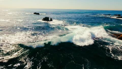 aerial view of beautiful laguna beach's waves breaking in the summer sun. - laguna beach california stock videos & royalty-free footage