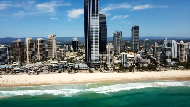 Aerial view of beautiful, rocky coast. City skyline