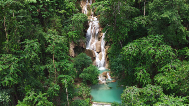 aerial view of beautiful tat kuang si waterfalls at luang prabang in laos - lagoon stock videos & royalty-free footage