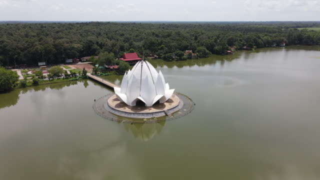 aerial view of beautiful white chapel in wat santiwanaram at udonthani province thailand. - water plant stock videos & royalty-free footage