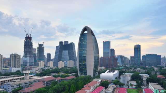 Aerial View of Beijing City Skyline and CCTV Headquarters, Day to Night Transition