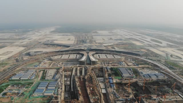 aerial view of beijing daxing new airport construction site - peking stock-videos und b-roll-filmmaterial