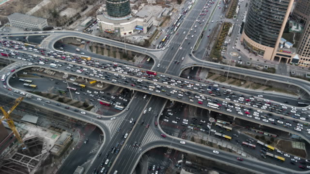 t/l ws ha pan aerial view of beijing road intersection / beijing, china - pechino video stock e b–roll