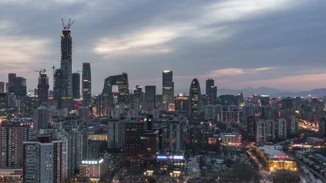 t/l ws ha zo aerial view of beijing skyline, day to night transition / beijing, china - international landmark stock videos & royalty-free footage