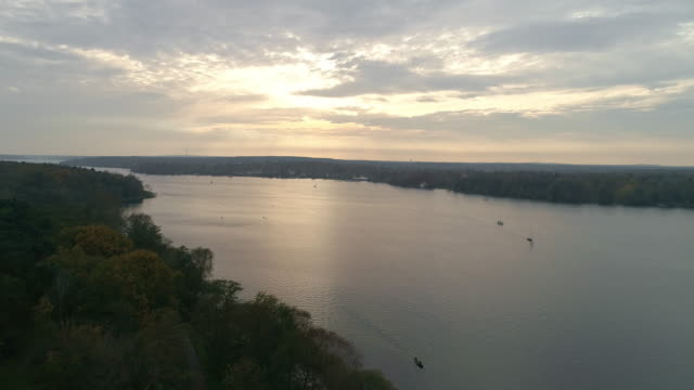 aerial view of berlin lakes at sunset - stehendes gewässer stock-videos und b-roll-filmmaterial