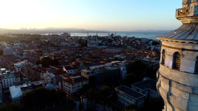 aerial view of beyazit tower and istanbul's historical peninsula in the background at sunrise - blue mosque stock videos & royalty-free footage