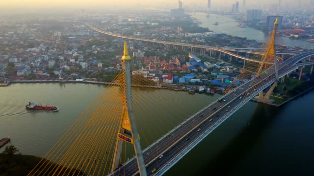 aerial view of bhumibol bridge industrial ring bridge crossing the chao phraya river twice. twilight, sunset scene at new landmark of bangkok - bangkok stock videos & royalty-free footage