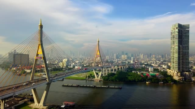 aerial view of bhumibol suspension bridge cross over chao phraya river in bangkok city - bangkok stock videos & royalty-free footage