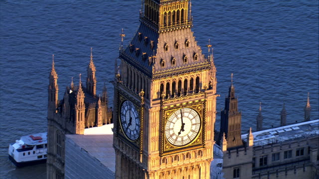 aerial view of big ben bell tower and clock face - big ben stock videos & royalty-free footage