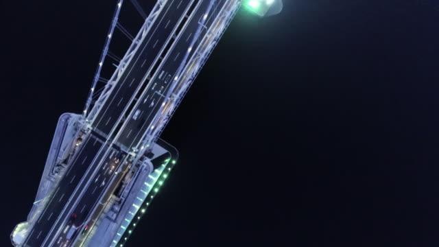 aerial view of big bridge at night - 橋点の映像素材/bロール