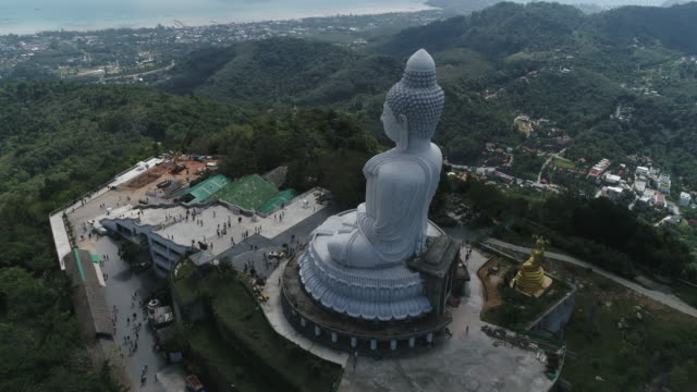 aerial view of big buddha on the mountain between karon beach and kata beach. - phuket stock videos & royalty-free footage