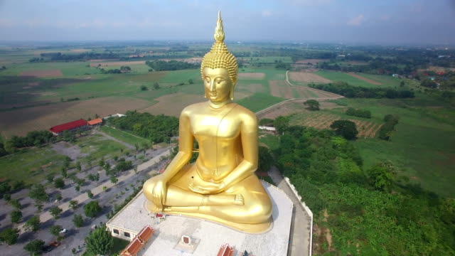 aerial view of big buddha statue in wat muang,thailand - buddha stock videos & royalty-free footage