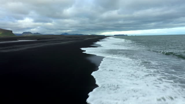 aerial view of black sands beach in iceland - contrasts stock videos & royalty-free footage