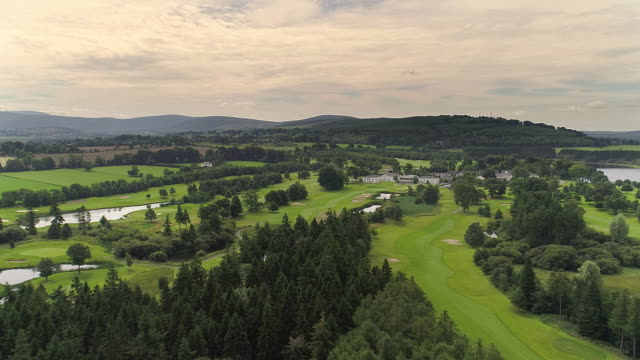 aerial view of blessington lake area in ireland - green golf course stock videos and b-roll footage