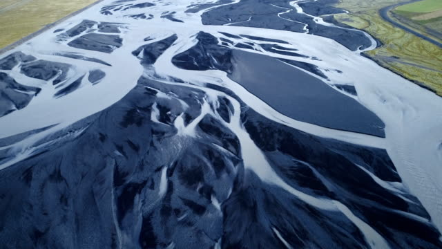 aerial view of  blue river in the mountains - iceland stock videos & royalty-free footage