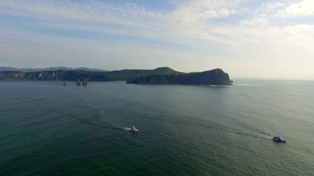 aerial view of boat in bay of petropavlovsk, kamchatka, russia - 固定された点の映像素材/bロール