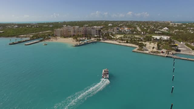 aerial view of boat in grace bay, providenciales, turks and caicos - provo stock videos & royalty-free footage