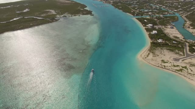 aerial view of boat in grace bay, providenciales, turks and caicos - turks and caicos islands stock videos & royalty-free footage