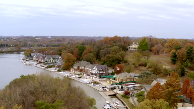aerial view of boathouse row on the schulkyll river in philadelphia, pennsylvania - rowing stock videos & royalty-free footage