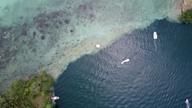 aerial view of boats at bacalar lagoon in mexico - tulum mexico stock videos & royalty-free footage