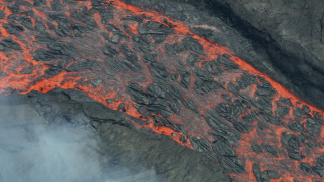 aerial view of boiling volcano red hot lava - tectonic stock videos & royalty-free footage