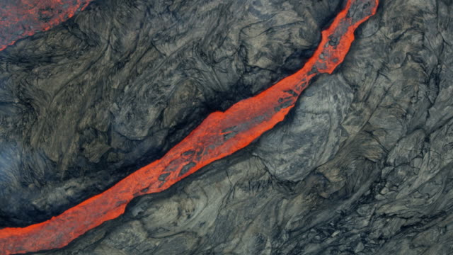 aerial view of boiling volcano red hot liquid - geology stock videos & royalty-free footage