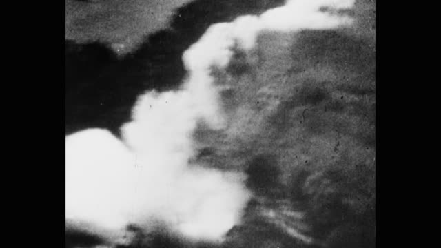 aerial view of bomb explosion on landscape - bomb stock videos & royalty-free footage