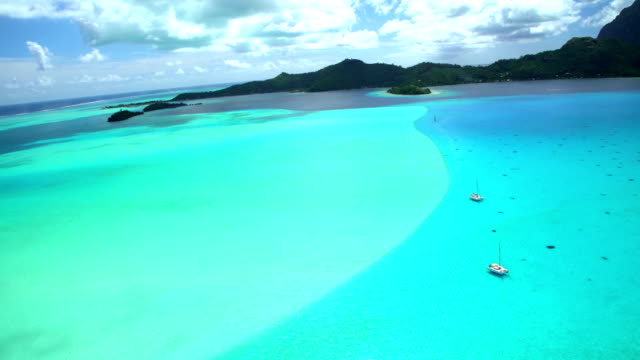 aerial view of bora bora island south pacific - reef stock videos and b-roll footage