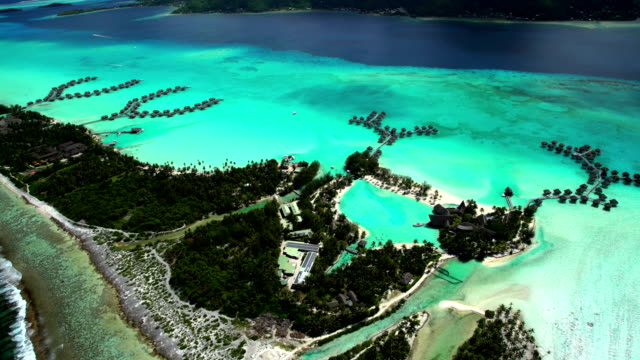 aerial view of bora bora island south pacific - bora bora aerial stock videos and b-roll footage