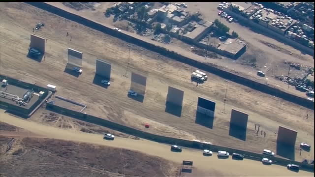 aerial view of border wall prototypes in otay mesa - 国境の壁点の映像素材/bロール