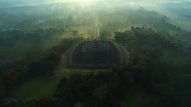 aerial view of borobudur temple on a moody morning - buddhism stock videos & royalty-free footage