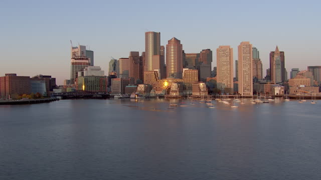 aerial view of boston harbor with modern cityscape, boston, massachusetts, united states of america - boston massachusetts stock-videos und b-roll-filmmaterial