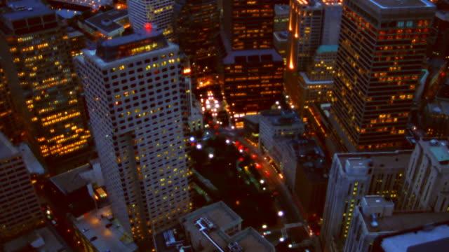 Aerial view of Boston, Massachusetts, lit at dusk.