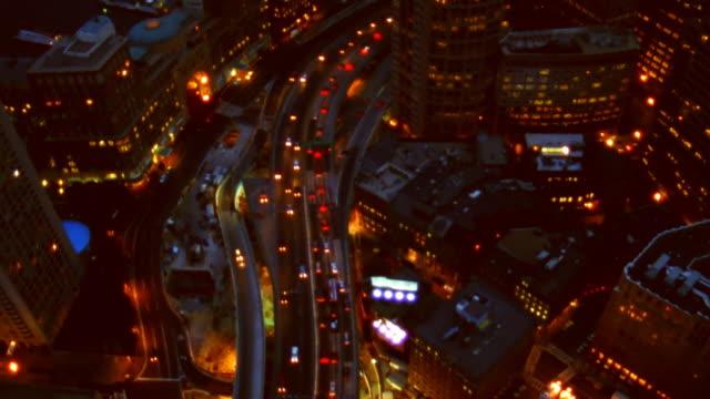 Aerial view of Boston, Massachusetts, lit at night.