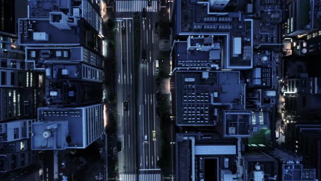 vidéos et rushes de aerial view of boulevard between office buildings - vue en plongée verticale