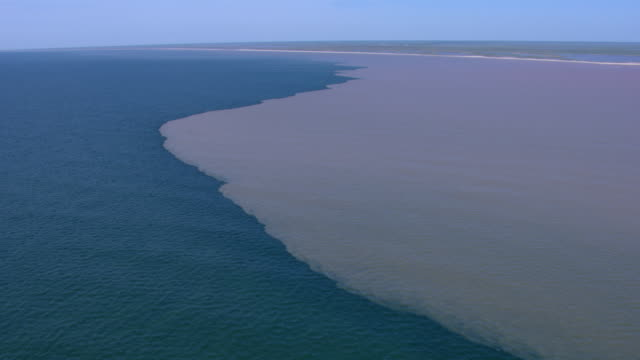 vidéos et rushes de aerial view of brazos river estuary and gulf coast near freeport, texas. - gulf coast states