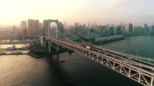 vídeos de stock e filmes b-roll de aerial view of bridge at night - tokyo japan