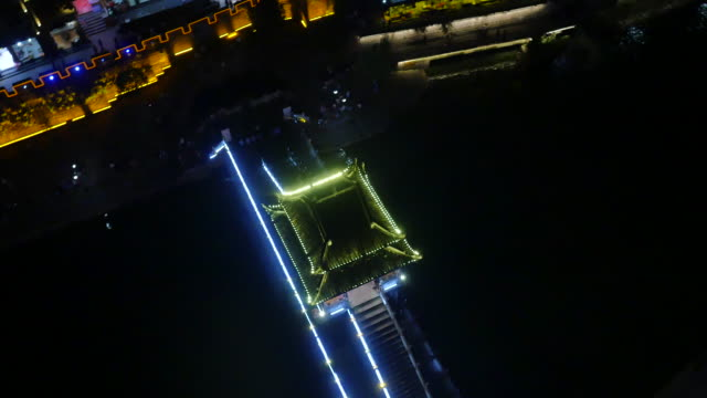 Aerial view of bridge in Phoenix Ancient Town (famous travel destinations) at night