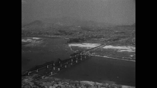 aerial view of bridge over river with cityscape, korean war - aircraft point of view stock videos & royalty-free footage
