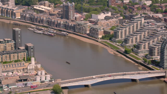 aerial view of bridges over the river thames in london, uk. 4k - battersea stock videos & royalty-free footage