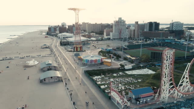 aerial view of brooklyn's coney island at dusk - coney island stock videos & royalty-free footage