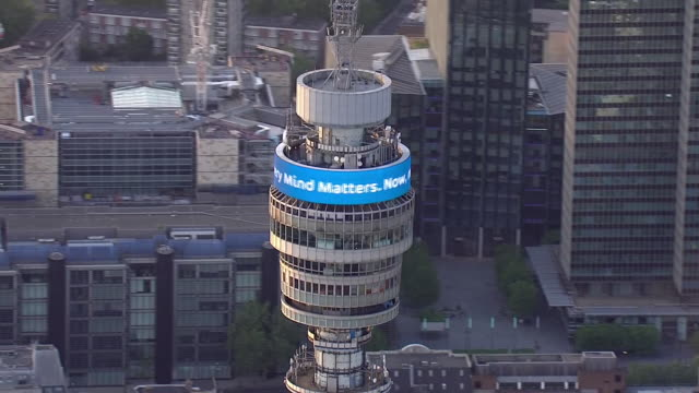 aerial view of bt tower lit up for nhs carers and key workers in a weekly moment of appreciation during the coronavirus outbreak on 7 may april 2020... - bt tower london stock videos & royalty-free footage