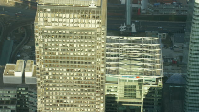 aerial view of building rooftops in city london - financial building stock videos & royalty-free footage