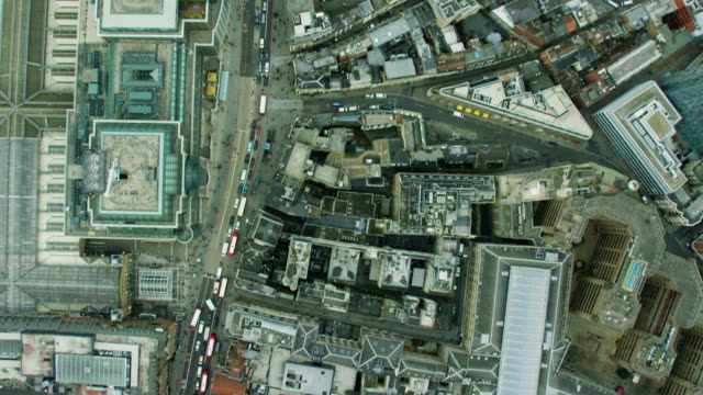 vídeos de stock, filmes e b-roll de aerial view of building rooftops in urban london - vertical